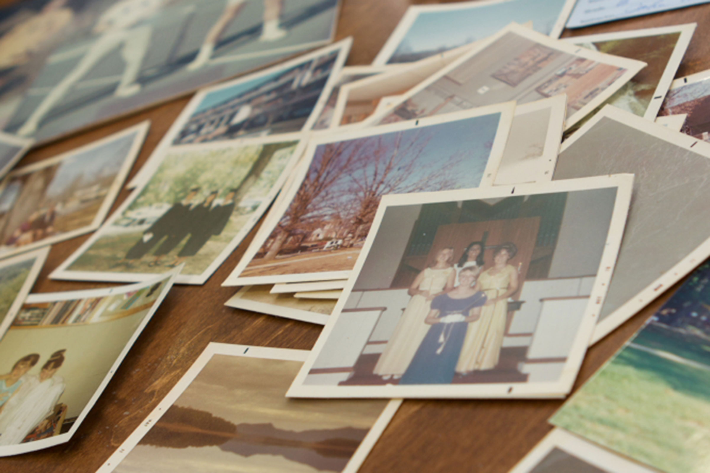 old photos scattered on a table