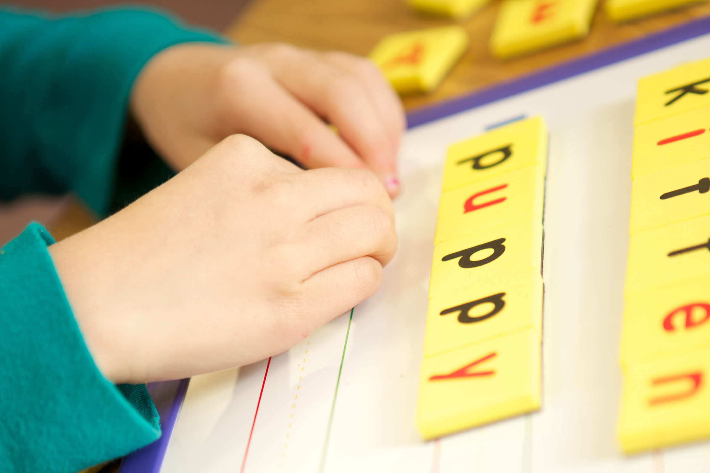 child playing with letter blocks