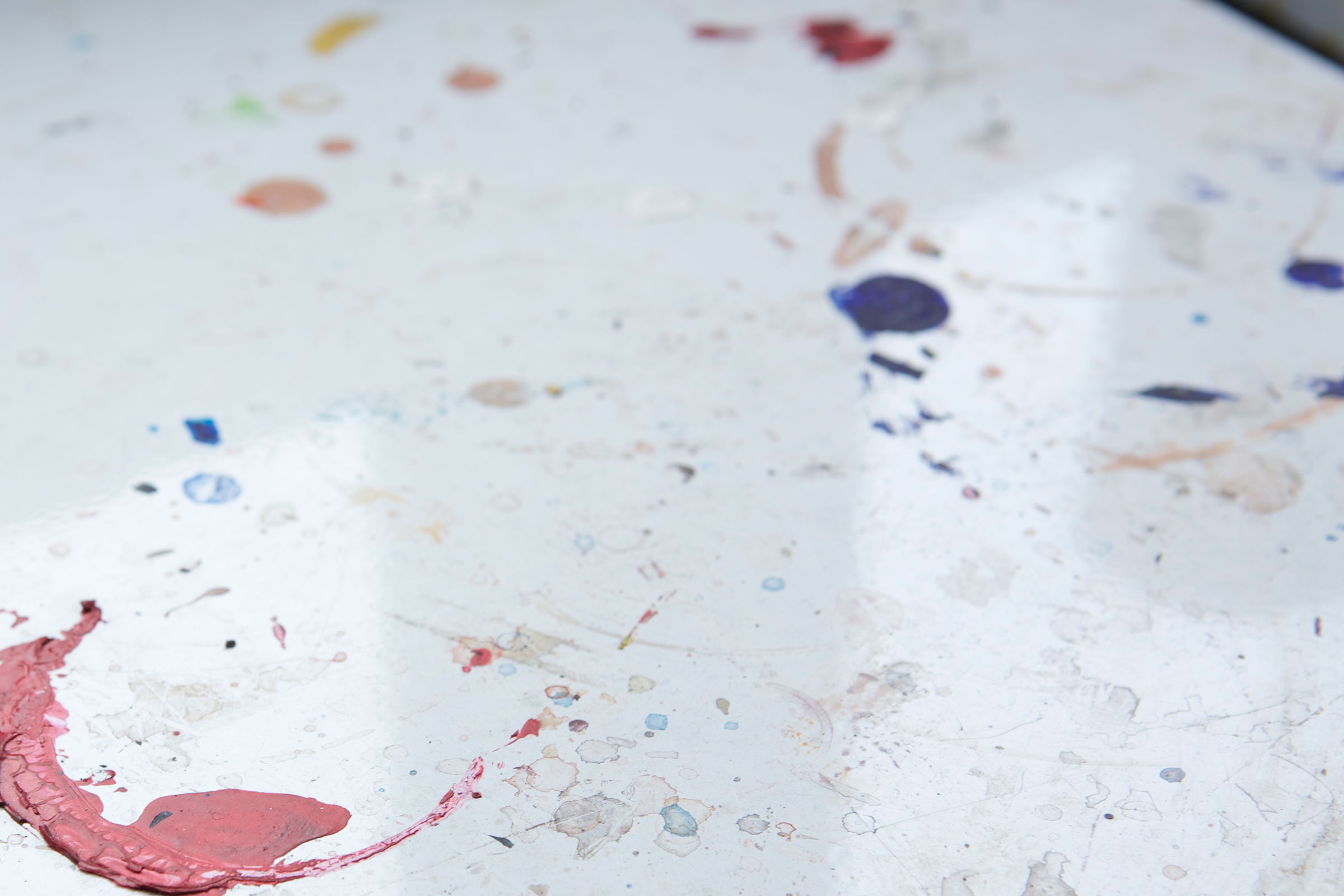 color paint splotches on white