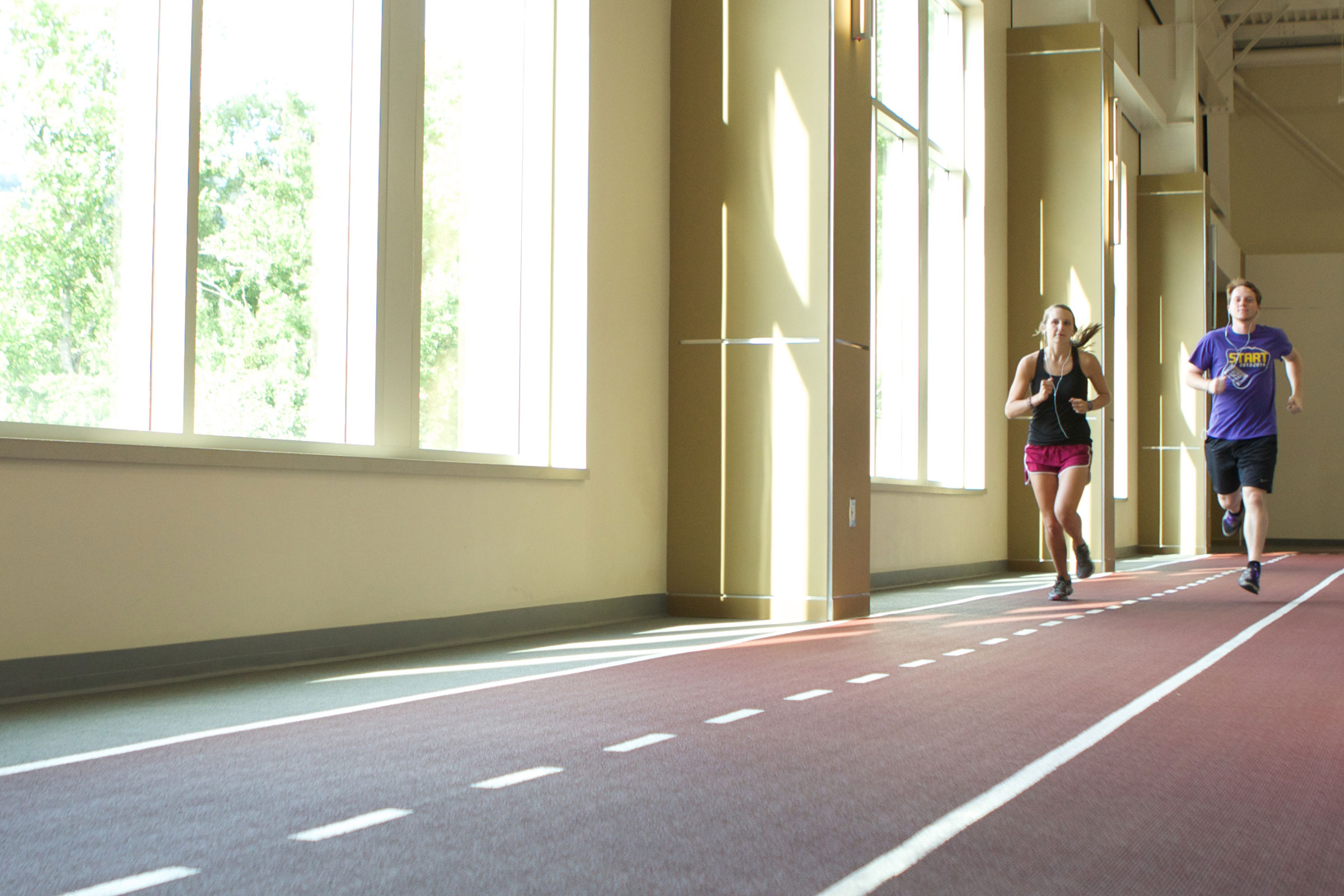 person running on indoor track
