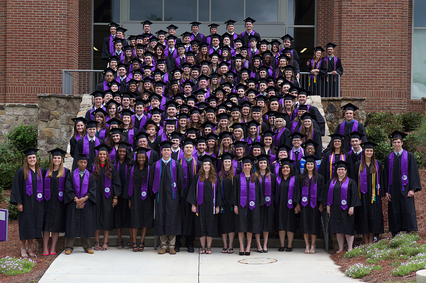 The 2014 graduates lined up on the steps in front of the Recreation and Fitness Center for a class photograph