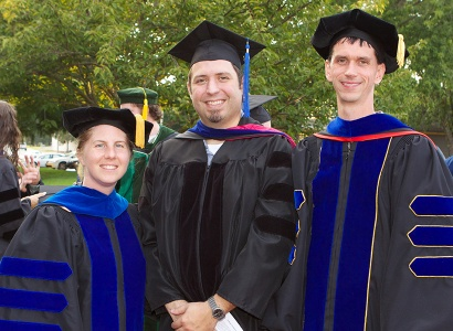 faculty members in cap and gowns