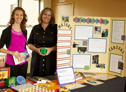 two people in front of poster board presentation