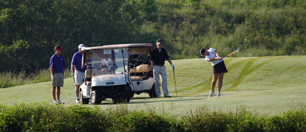 golfers with golf cart