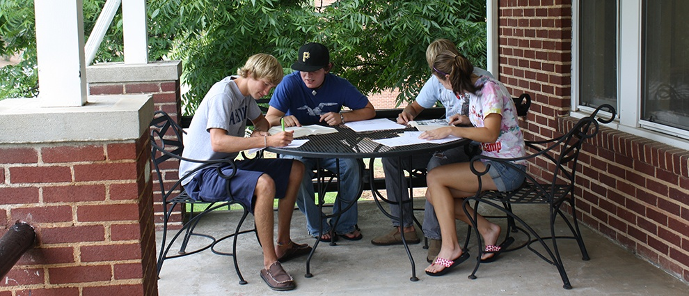 students studying on patio