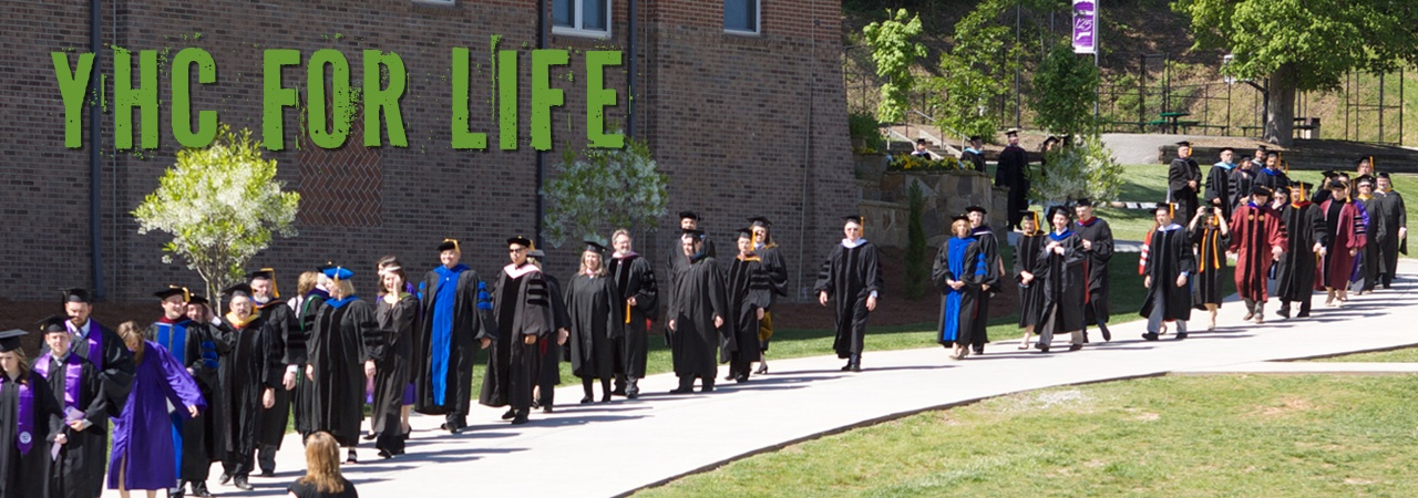 faculty in cap and gowns