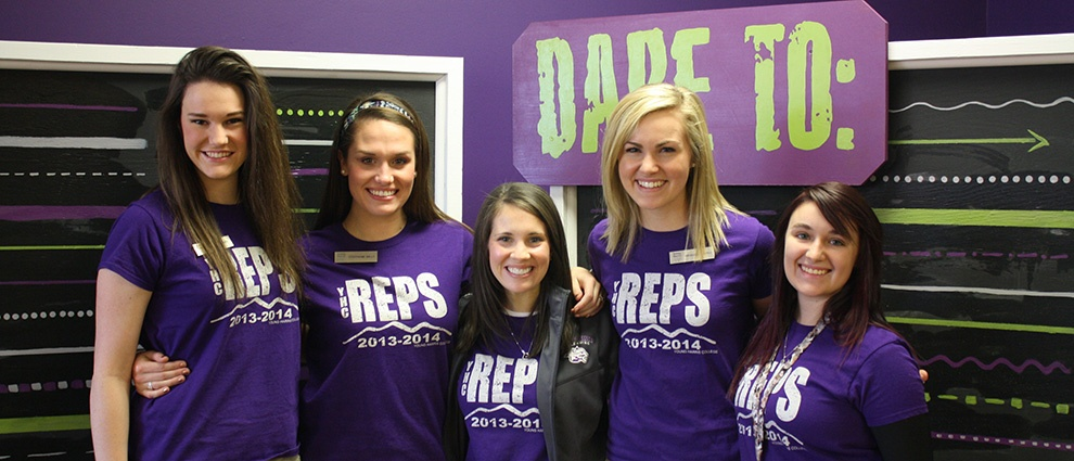students in purple reps shirts