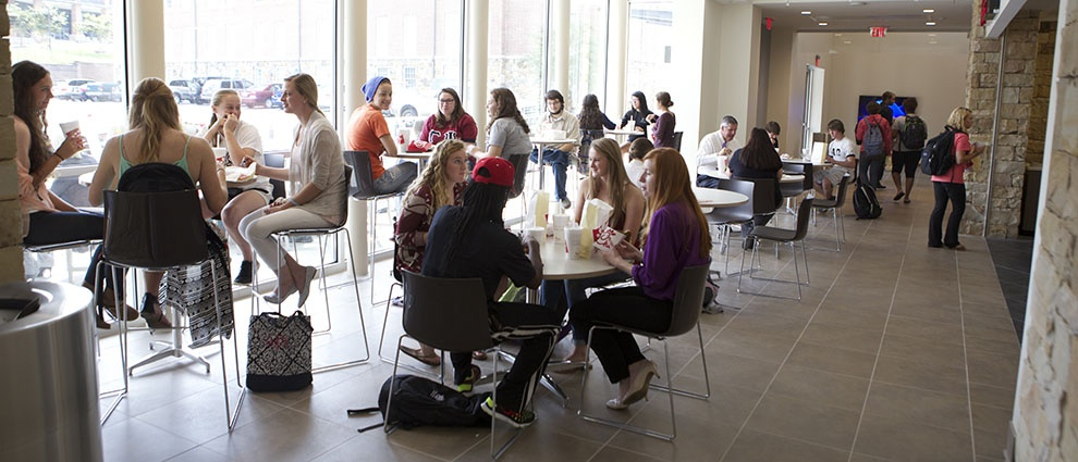 students eating at tables