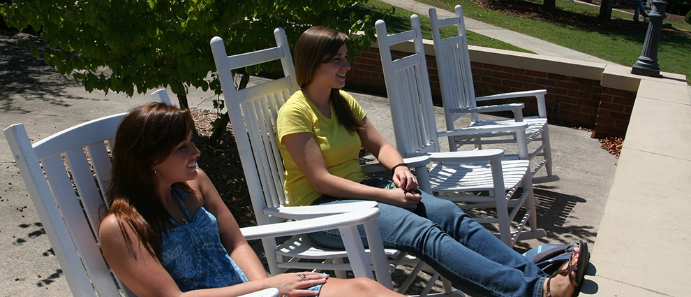 students on rocking chair