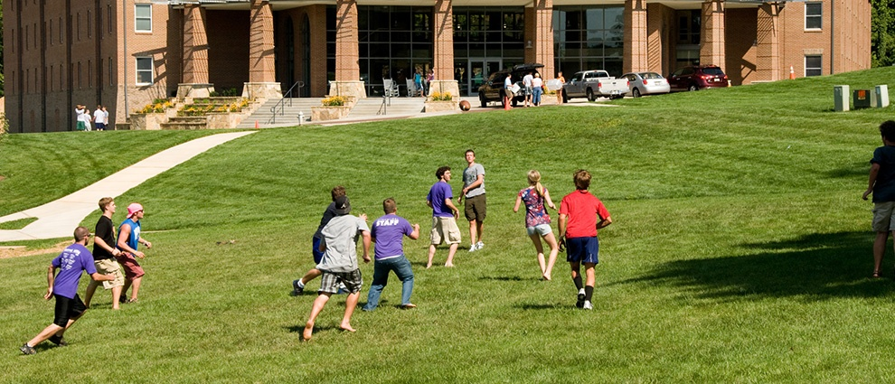 students playing game on lawn