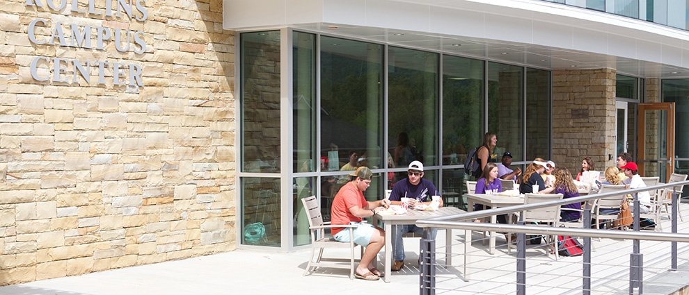 students at tables outside rollins campus center
