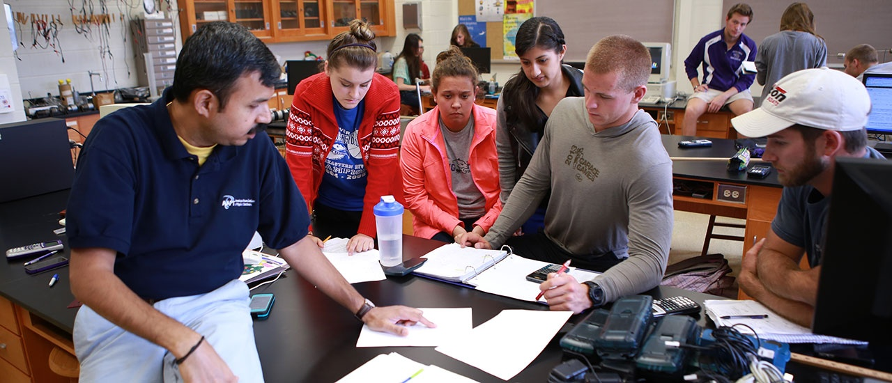 students in group in science class