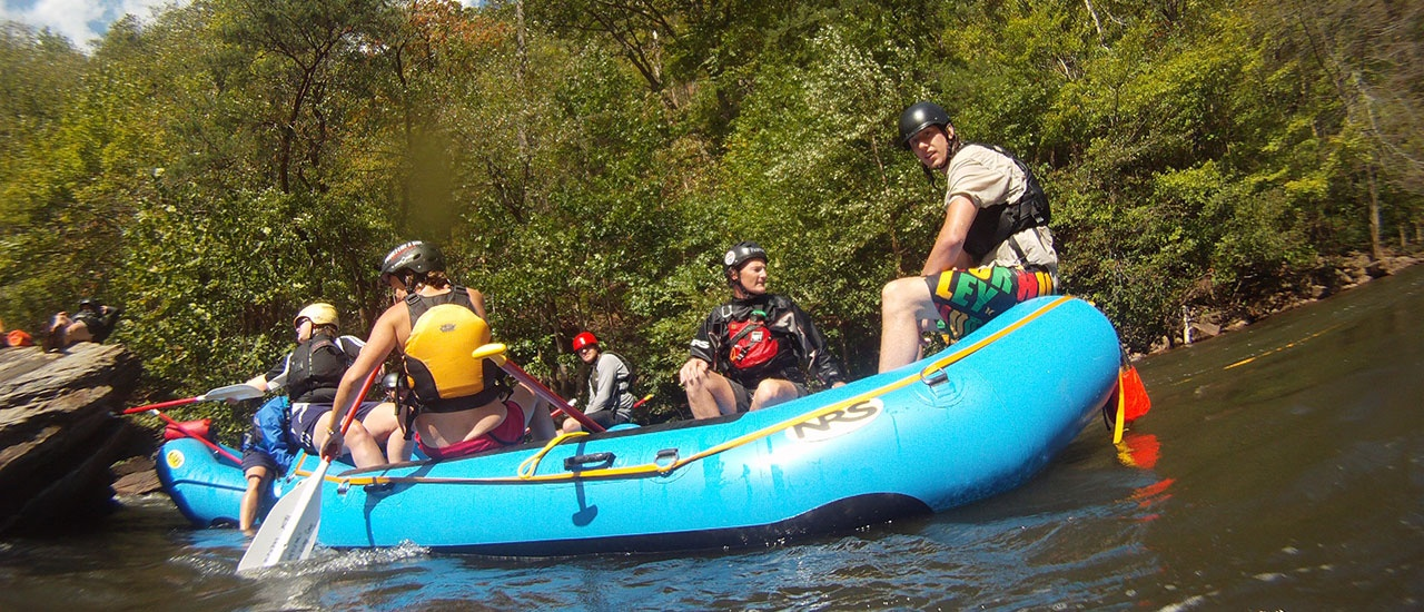 students in raft