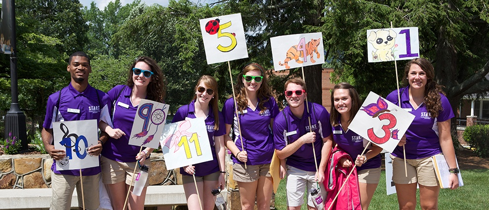 students with fun picket signs
