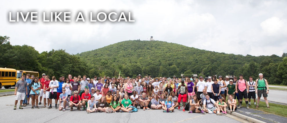 large group of students in front of mountain scene