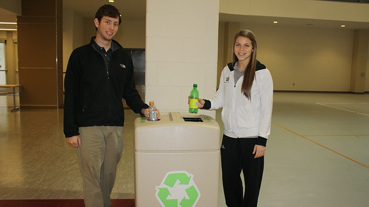 students in front of recycling box