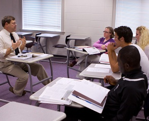 students at desks in class