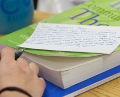 textbook with index card