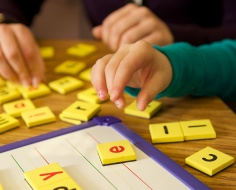 children playing with letter block