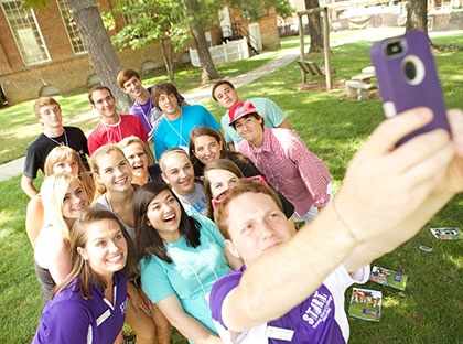 students taking group selfie