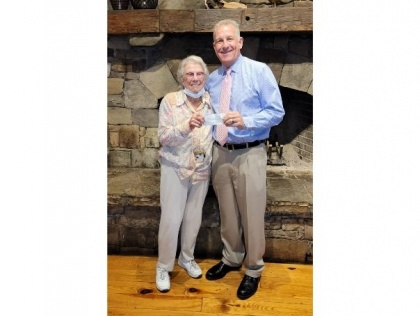 Hiawassee resident Ethel Winters (left) met Vice President for Advancement Mark Dotson (right) at Brasstown Valley Resort with a $1,000 donation to support local students at Young Harris College.