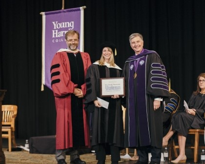 Dr. Claudie Massicotte (middle) is presented with the Vulcan Teaching Excellence Award by Provost Dr. Jason Pierce and President Dr. Drew L. Van Horn.