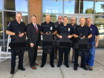 Representatives from the Georgia Fraternal Order of Police visit Young Harris College to donate four ballistic vests to the police department.