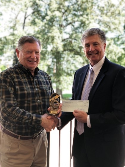 Tom Spencer with Big Brothers Big Sisters presents donation to YHC President Dr. Drew L. Van Horn