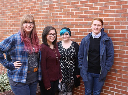 YHC Students in front of brick wall