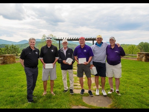 Winners of the 2021 Clay Dotson Open Alumni Challenge included Jarrell Johnson, '77, Jim Hudgins, '77, Grady Mosley and John Sillay, '75. They are pictured between Dr. Drew Van Horn, president of Young Harris College, and Dr. Clay Dotson, for whom the tournament is named.