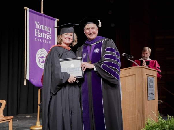 Young Harris College Associate Professor of Theatre Anne Towns (left) is presented with the 2021 Vulcan Teaching Excellence Award by Dr. Drew L. Van Horn, president of YHC.